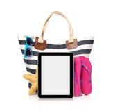 Bolso y tableta de la playa Fotografía de archivo libre de regalías