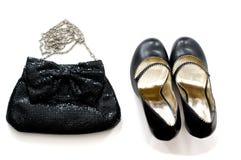 Bolso y zapatos de embrague sobre blanco Fotografía de archivo
