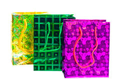 Bolsos coloridos con el modelo olográfico para los regalos Fotografía de archivo