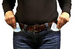 Bolsos completos do dinheiro das calças de brim fotos de stock
