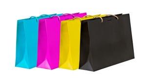Bolsos de compras ciánicos, magentas, amarillos y negros. Fotografía de archivo libre de regalías