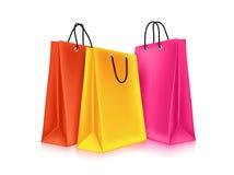 Bolsos de compras coloridos ilustración del vector