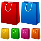 Bolsos de compras coloridos fijados Fotos de archivo