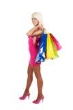 Bolsos de compras de la mujer que llevan hermosa joven Imágenes de archivo libres de regalías