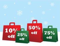 Bolsos de compras de la venta de la Navidad Imagenes de archivo
