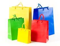 Bolsos de compras de la venta rojos, azul, amarillo Imagen de archivo