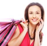 Bolsos de compras felices de la mujer de las compras que se sostienen. Foto de archivo libre de regalías