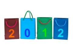Bolsos de compras y números 2012 Fotos de archivo libres de regalías