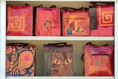 Bolsos de cuero coloridos brillantes Imagenes de archivo