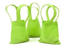 Bolsos de neón verdes del paño con las sombras Imágenes de archivo libres de regalías