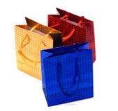 Bolsos de papel brillantes del regalo Fotografía de archivo libre de regalías