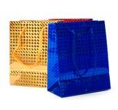 Bolsos de papel brillantes del regalo Fotos de archivo libres de regalías