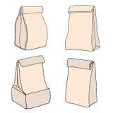 Bolsos del almuerzo del papel de Brown La comida empaqueta la colección Paquete de la entrega de la comida Foto de archivo libre de regalías