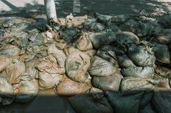 Bolsos del cemento en piso foto de archivo libre de regalías