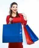 Bolsos del control de la mujer de las compras, retrato aislado Fondo blanco Fotografía de archivo
