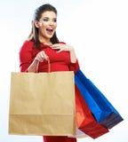 Bolsos del control de la mujer de las compras, retrato Fondo blanco Foto de archivo