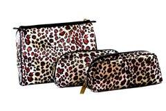 Bolsos del maquillaje del leopardo fotografía de archivo