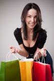 Bolsos felices de la explotación agrícola de la muchacha de compras Imagen de archivo