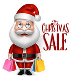 Bolsos realistas de Santa Claus Cartoon Character Holding Shopping Foto de archivo