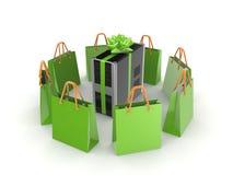 Bolsos verdes alrededor de la PC. Foto de archivo