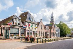 Houses and shops on quay and tower of town hall in old town of B Stock Photo