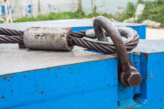 Bolt anchor shackle and wire rope sling. Close up heavy duty bolt anchor shackle and wire rope sling on crane counter weight Stock Image