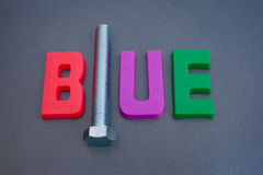 A bolt from the blue. A macro image illustrating the phrase ' a bolt from the blue ' using colorful upper case letters with the letter L replaced with a bolt royalty free stock images