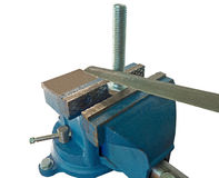 Bolt clamped in a vise Royalty Free Stock Images