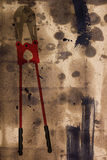 Bolt Cutter on the damaged paper Royalty Free Stock Image
