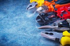 Bolt cutter tin snips cutting pliers gripping Stock Photos