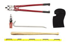 Bolt cutters, baseball bat, balaclava, pliers and other props of burglary documented as evidence of crime on white background Stock Image