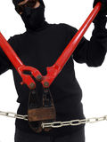 Bolt Cutting Man. Masked man cutting a chain with well worn bolt cutters Royalty Free Stock Photo