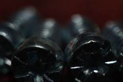 Steel bolt in maximum macro shooting. Bolt - fastener in the form of a rod with an external thread, as a rule, with a hexagonal head under a wrench, forming a stock image