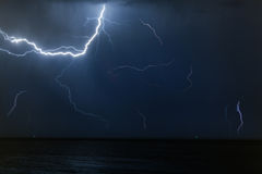 Bolt of lightening in a night sky Stock Photography