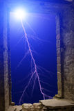 Lightning flash stone window Royalty Free Stock Images