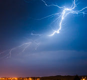 Bolt of lightning strikes in the sky Royalty Free Stock Image