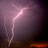 Bolt of lightning on sunset.  royalty free stock image