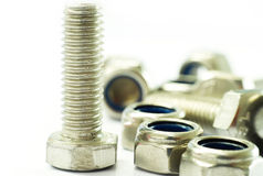 Bolt and Lock Nut. Stainless Steel Bolt and Lock Nut on white background Stock Image
