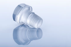 Bolt made of transparent plastic on blue Stock Images