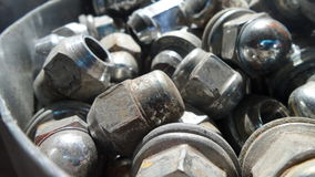 Bolt and nut in the garage shop Stock Photos