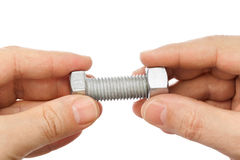 Bolt and nut in hands Stock Photography