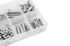 Bolt and nut in plastic organizer box. On whhite stock photography
