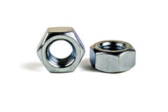 Bolt and Nut. Two new nut on a white background royalty free stock image