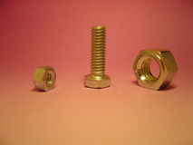 Bolt & nuts. A suggestive standing bolt with two nuts Stock Photos
