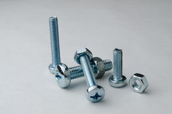 Bolt and nuts screwed together Stock Photos