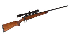 Bolt rifle. Wood stocked bolt action rifle with a high powered scope Stock Photo