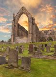 Bolton Abbey sunrise. Bolton Abbey in Wharfedale in North Yorkshire, England, with the ruins of a 12th-century Augustinian monastery Royalty Free Stock Photos
