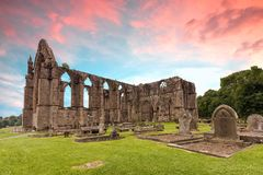 Bolton Abbey sunset. Bolton Abbey in Wharfedale in North Yorkshire, England, with the ruins of a 12th-century Augustinian monastery Stock Photo