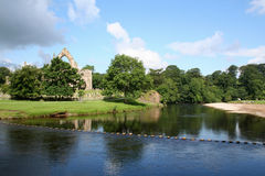 Bolton Abbey, Yorkshire. The Remains of an old abbey in Wharfedale in the Yorkshire Dales National Park.Tourists relax by the river royalty free stock image
