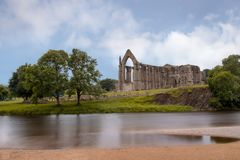 Bolton Abbey in Yorkshire Dales. Bolton Abbey in Wharfedale in North Yorkshire, England, with the ruins of a 12th-century Augustinian monastery Royalty Free Stock Photos